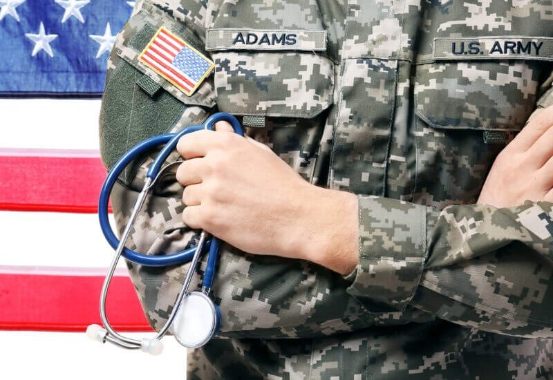 Military Man Holding a Stethoscope